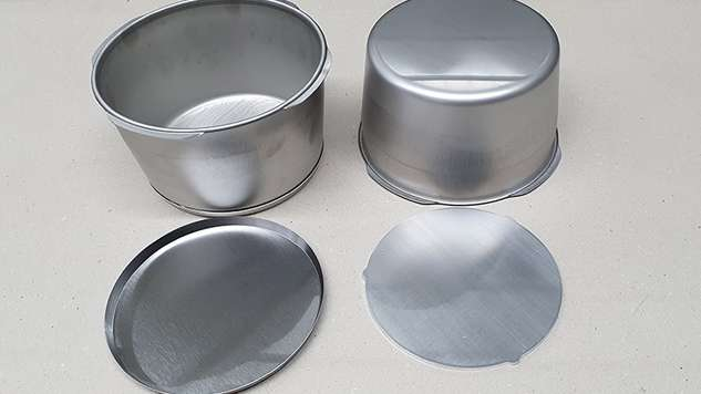 The three components before bonding: Pot, stainless steel base and aluminum blank.